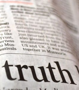 newspaper with the word truth highlighted
