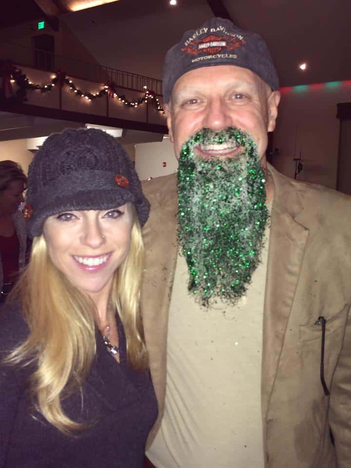 Randy with green glitter beard posing with daughter