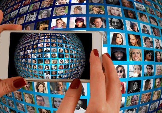 Audit Social Media Marketing Strategy Third Angle - Smartphone viewing sphere of faces